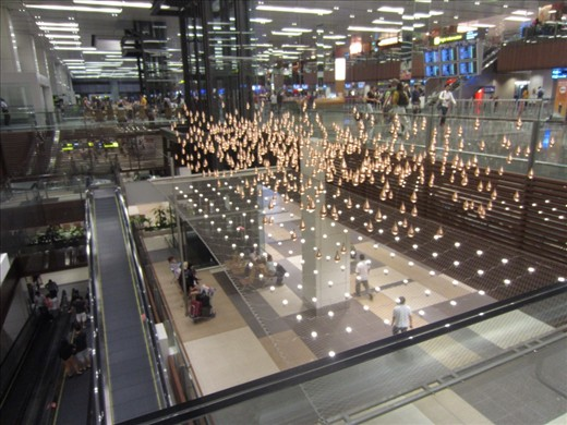 installation at the Singapore airport.  These gold balls are on strings and they move in different formations.