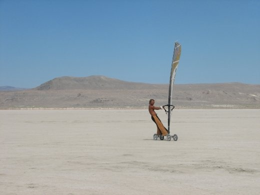 Seeing this man ride a skateboard with a windsurf sail attached across the open space of the desert was such a beautiful sight to see.