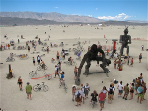 This photograph was taking from a hand built wooden tower that peered over larger than life size welded  sculptures. Looking down upon these sculptures the people appeared  looking in awe and amazement at the mere size of this artistic feat.