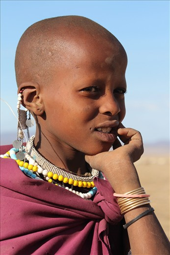 This Masai girl has followed in the footsteps of her father and brother herding the goats and cattle. School is of very little interest to her as farming is her main priority.
