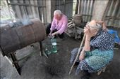 A local wine-maker along with his mother controls the process of home-brew alcohol distillation.: by anice, Views[238]