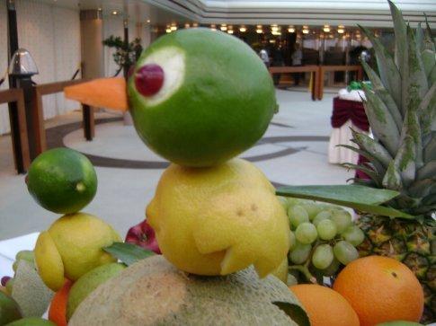 Adorable fruit bird on the ship.