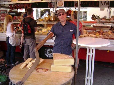 Philip cutting the cheese in Salzburg, Austria
