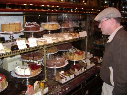 Admiring the pastry case in the world-famous Demel patisserie.