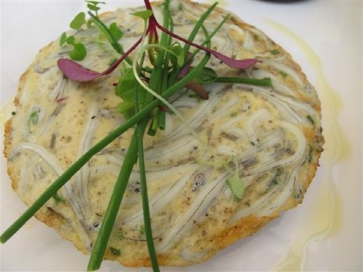 Whitebait fritters, a New Zealand delicacy.  Can you see the tiny fish and their eyes?