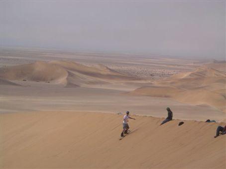 Simon sandboarding in Namibia