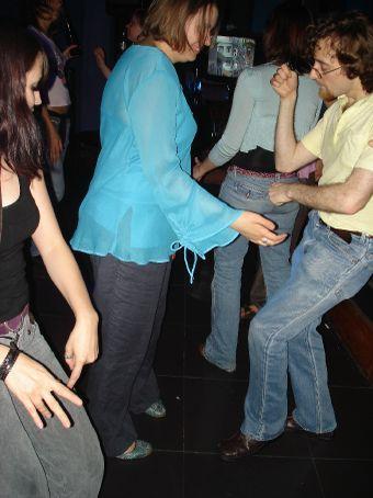 Jill (blue shirt) dancing with a crazy dude