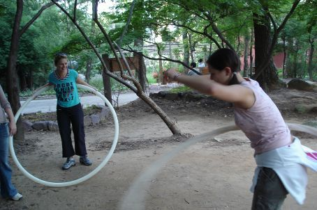 Playtime in the exercise area of Geumgang Park - old ladies have no problems hula-hooping these!