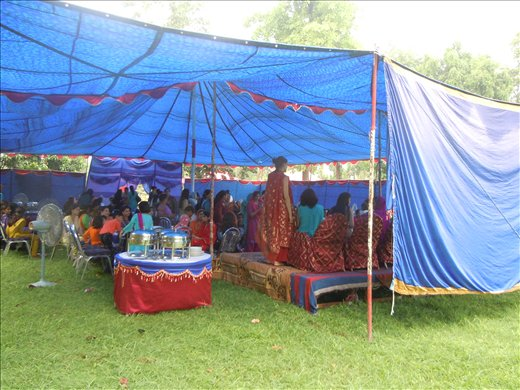 tent for women's wedding festivities (stage for bride on right)