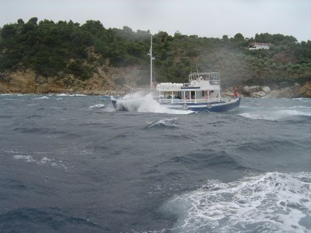 The storm has come in -- turning around and spray is coming on the boat -- this was a similar boat next to us