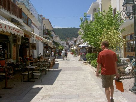 Walking down the main street in Skiathos with my laptop