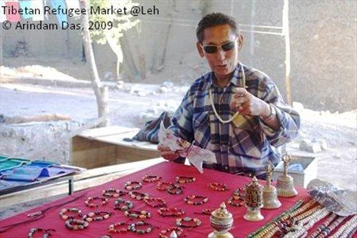 Tibetan refugee at Leh bazaar: back to materialistic possessiveness