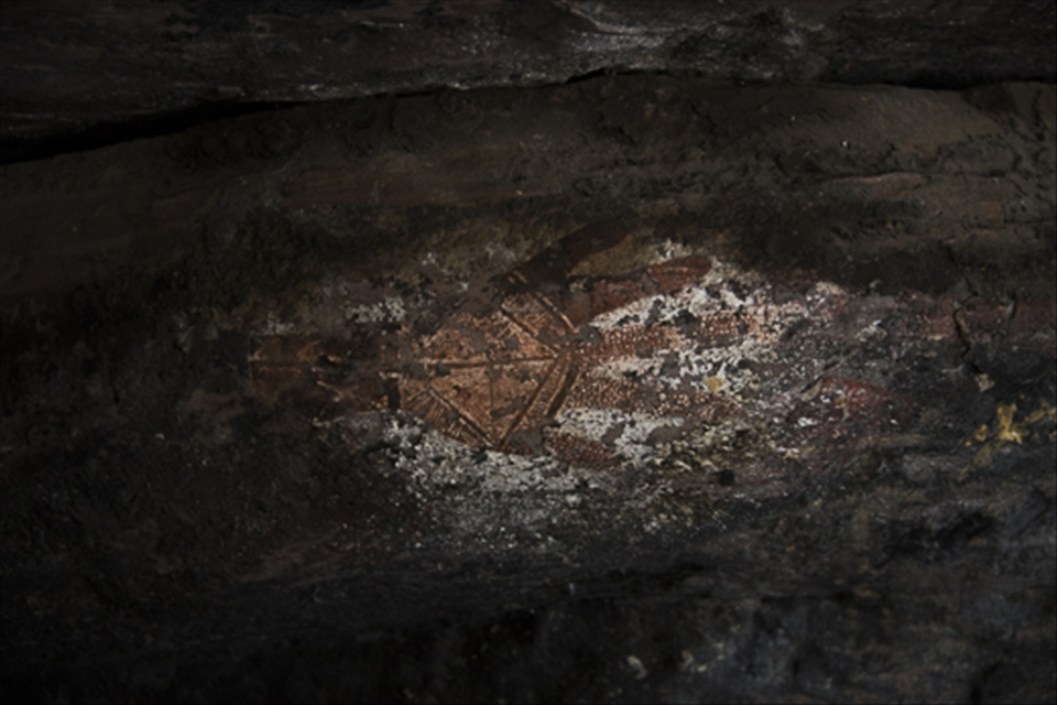 This is a traditional Aboriginal cave painting at Injalak Hill, 5kms west of Gunbalanya in Arnhem Land, NT. Painted with white and red ochre this painting is believed to be over 10,000 years old. Hand stencils are very common in Aboriginal rock painting, this particular one is considered very rare due to the detail added into what would normally be negative space.