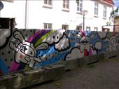 Street art in Aalborg centrum - it consists of a number of space-age rabbits and says