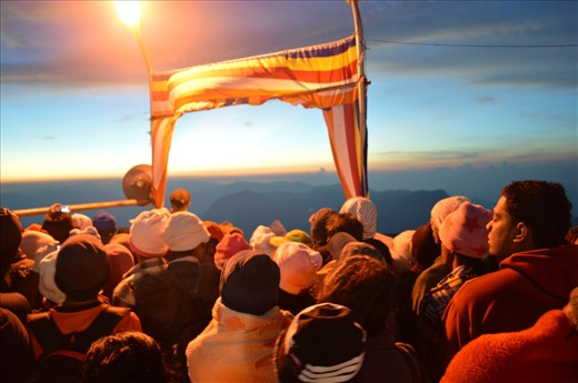People from many countries including the locals are waiting for the most spectacular event at the top of the Adam's Peak.  It's the sunrise of a new day. People climb 2,243 metres (7,359 ft) to see this and the most of Buddhists do this as a pilgrimage as they believe the sacred foot print of Lord buddha.