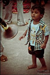 a kid watching nadaswaram. and wondering how does the man play it. (nadaswaram is a musical instrument) : by arul_anand, Views[234]