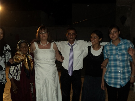 Fateh and me dancing with some of his family at the wedding party