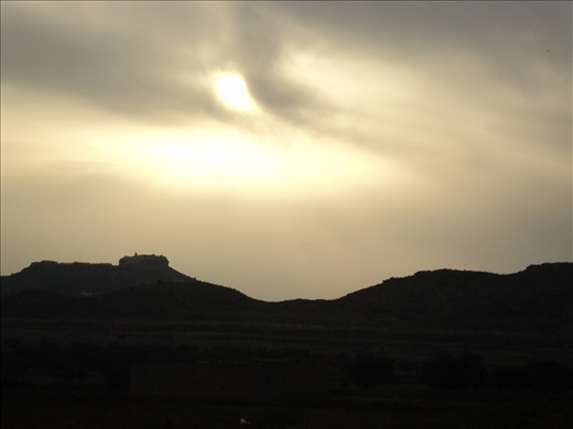View of Takrouna at sunset with the air full of smoke from burning of rubbish. Makes for interesting effect round the sun!