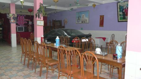 Multi-functional dining room: restaurant and garage. Seen in Dien Bien Phu, Vietnam.