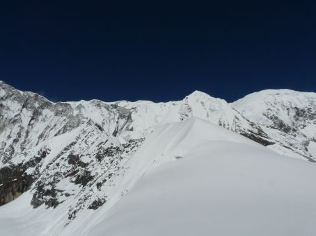 View of the utter east face of Annapurna and Singha Chuli, taken from the foot of the ridge...
