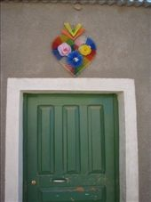 Have to get back to you on what these are all about.  Appear above numerous doors in villages.: by bagen, Views[277]