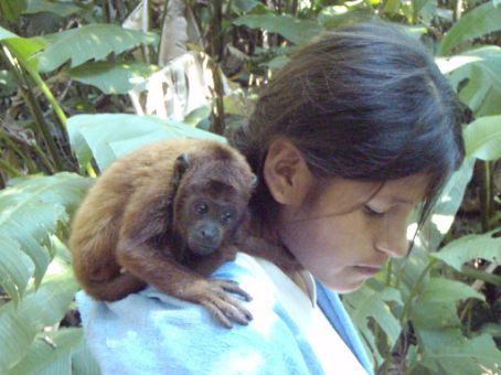 Roomey the baby howler monkey.  With Euginia one of the Bolivian camp residents.