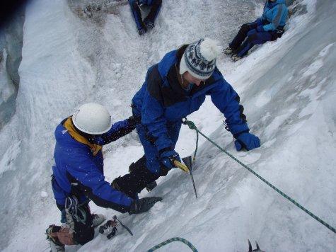 Ange sending ice flying on her way down a ridge