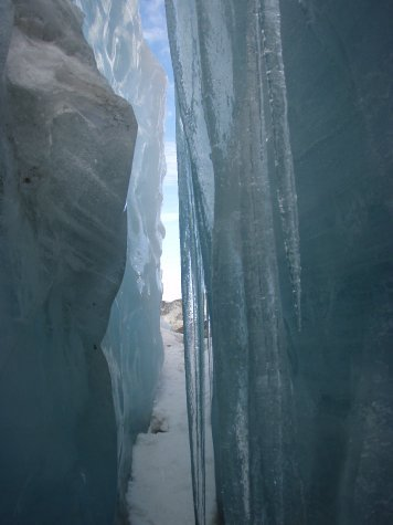 Peering through a crevasse in the glacier