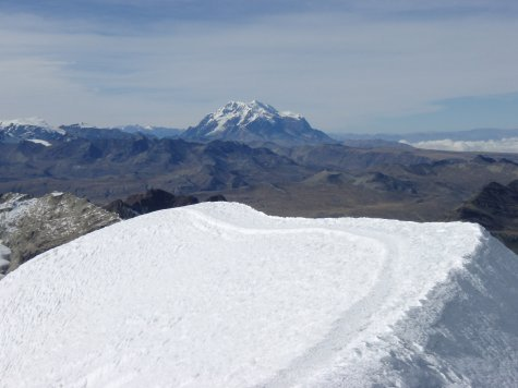 Looking across a snow ridge to an even bigger mountain. NO! we are not going to climb that one!