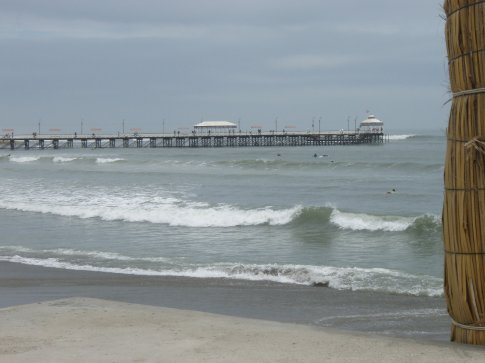 The waves of Huanchaco and the pier in the background.