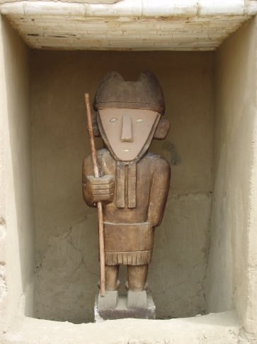 Original wooden carving guy doing what wooden carving guys do!