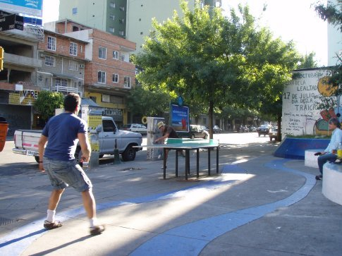 Ping pong match.  On a street corner.  Gotta love this city