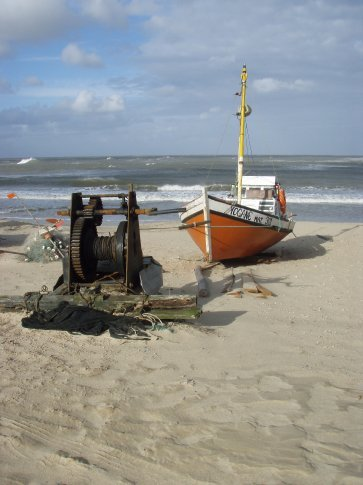 Old fishing boats.  Each has its own winch set up on the beach.