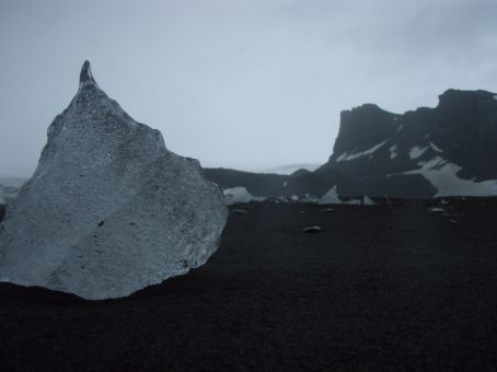 Ice. On volcanic beach sand