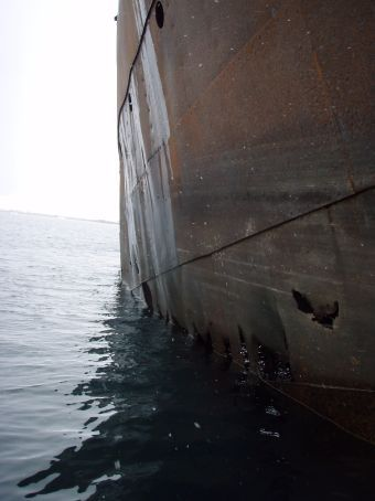 Side of a ship wreck. It caught fire and they beached it to try and save the whale oil