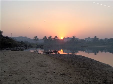 Sunrise on the morning of Shivaratri Festival.  (the local deity is brought from the temple in the forest to get blessed in the sea) This sunrise is by the lagoon on the south end of Patnem.