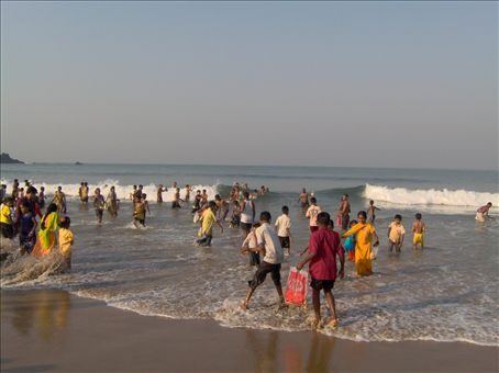 The sea, now full of bananas, the men and children dive in to collect them.  Everyone is happy and excited.  They throw the bananas for luck but still not sure why they collect them.