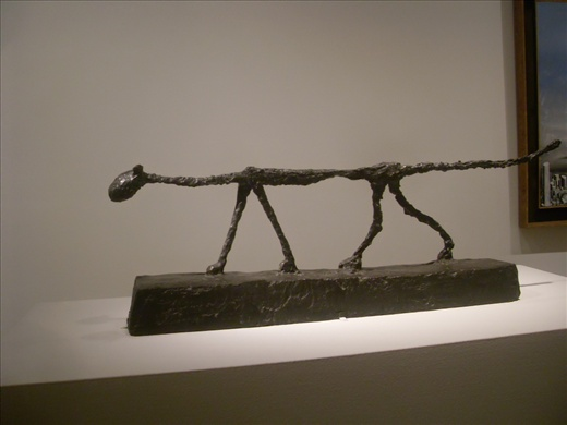 Thin Cat passing through the people by Giaccometti. Metropolitan Museum