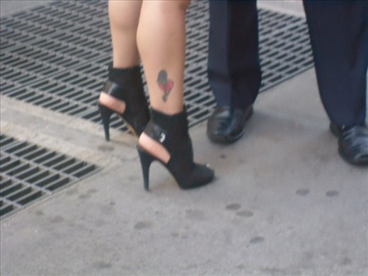 Shoes. Policeman with girl's heart tatoue on heels