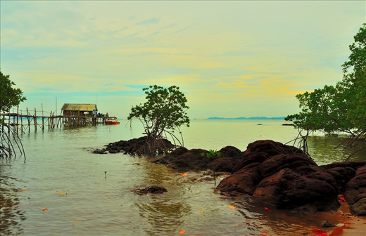 In  Batam you will see many of this type of house, literally people living above water, and use boat for transportation, I guess they live while enjoying life by watching sunset just right outside their window