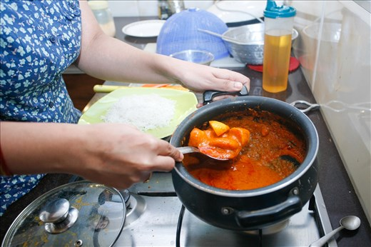 A close up of the curry simmering on the stove