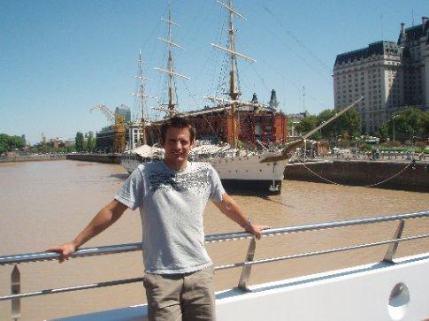 Simon on a ship shaped bridge with ship behind