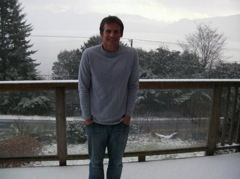 Simon freezing in the snow on our balcony