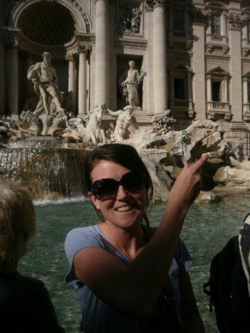 Bec flipping a coin into Trevi fountain for good luck
