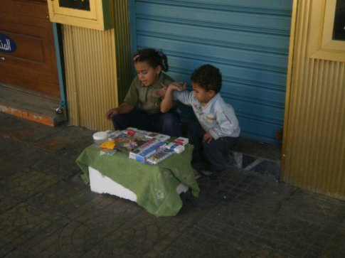 Little kids selling stuff on the streets of Amman