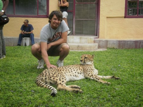 Simon patting the cheetah