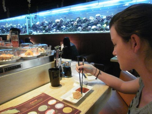 Eating at the freaking cool sushi restaurant, check out the massive aquarium