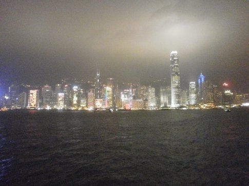 Night across the harbour, the tower looked like it should be shooting the Bat Sign into the clouds/smog