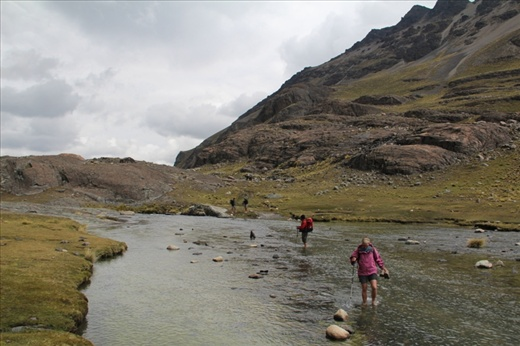 The walk starts by fording a freezing mountain stream