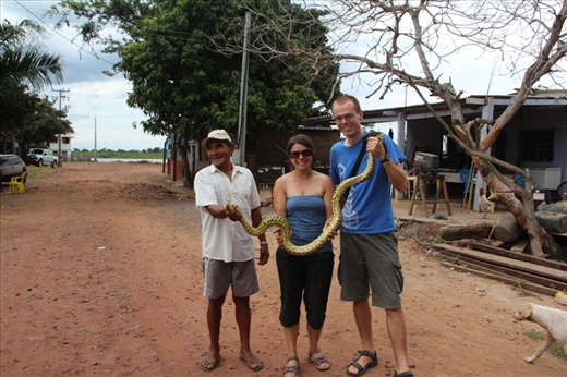 Posing with the wild anaconda before it was thrown into the river. Pantanal